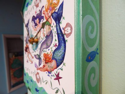 Danasimson.com mermaid pendulum wall clock side view