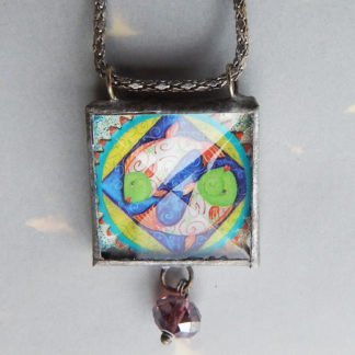 Danasimson.com Looking glass double-sided glass pendent sing yang fish. Beveled glass with a bead detail.