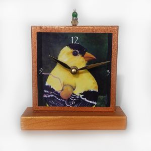 the Finch Precious Time Shelf Clock is hand painted in metallic copper and gold paint- with a bead detail. My yellow finch holding a gold heart in his wings is the clock face image.