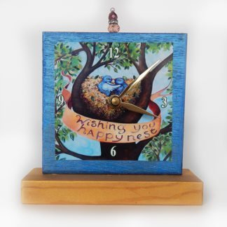 Danasimson.com Happy Nest Precious Time Shelf Clock is blue and gold with two birds in a nest in a tree- it says wishing you happy nest on a banner.