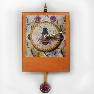 Danasimson.com Honey bee with winter pansies image on hand crafted wooden clock painted gold, bead detail and fancy pendulum