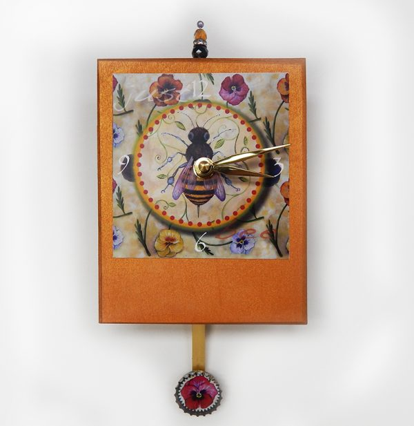 honey bee with winter pancies image on hand crafted wooden clock painted gold, bead detail and fancy pendulum
