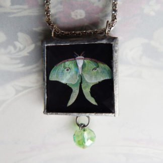 Danasimson.com Looking glass double-sided glass pendent Luna Moth. Beveled glass with a bead detail.