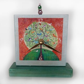 Danasimson.com Many Birds Tree Precious Time Shelf Clock is shimmery light blue and forest green paint on wood with an archival print of my Many Birds One Tree painting. There is a bead detail at the top of the clock.