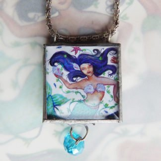 Danasimson.com Looking glass double-sided glass pendent mermaid. Beveled glass with a bead detail.