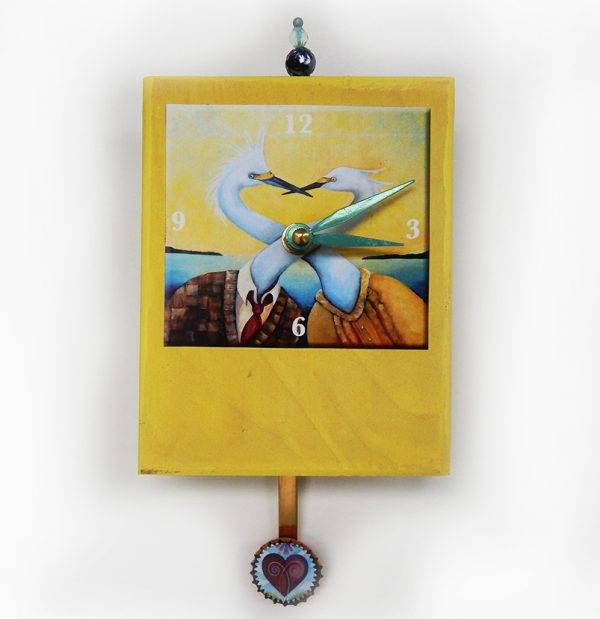 Egrets Precious Time Clock has two egrets in a suit and a dress with their necks entwined the title is NoEgrets. Wooden clock body is yellow- a little heart is in the bottle cap pendulum. It has a bead detail on top.