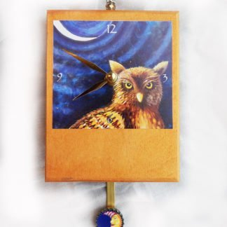Danasimson.com Night Owl Precious Time Pendulum Clock has a hoot owl under a sliver moon-there is a small moon face with a night cap on the bottle cap pendulum the wooden body of the clock is painted metallic gold.