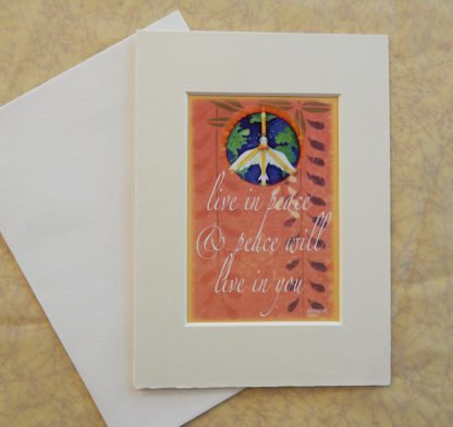 "Danasimson.com Matted art card with envelope, ""Live in peace and peace will live in you"" quote, peace dove over earth image."