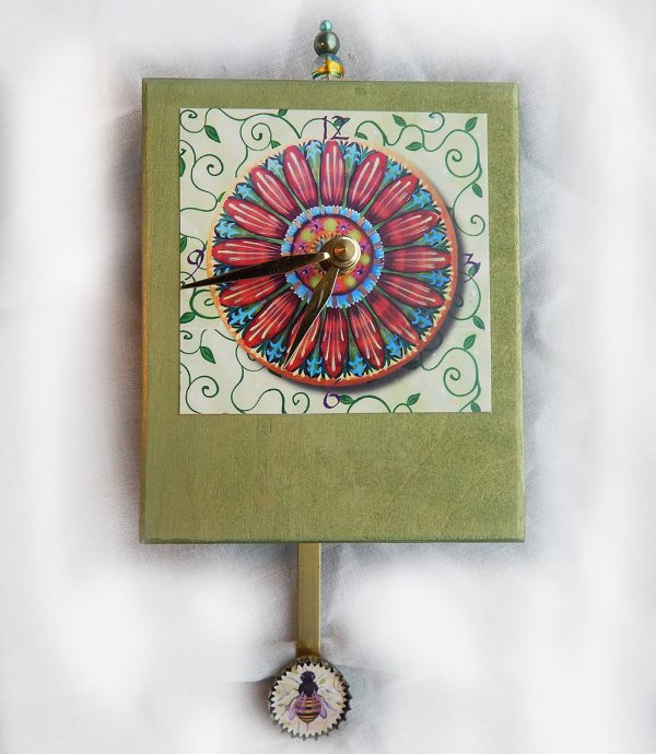 Pop Art Flower Precious Time Clock has a colorful daisy as the main image and a honey bee on the bottle cap pendulum. The wooden body of the clock is painted a pleasant emerald green. There is a bead detail at the top.