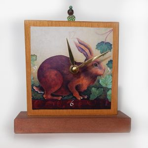 Rabbit Precious Time Shelf Clock is hand painted gold & copper with a bead detail at the top. An archival print of my rabbit and ivy painting is the clock face.
