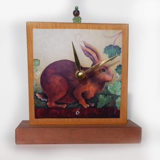 Danasimson.com Rabbit Precious Time Shelf Clock is hand painted gold & copper with a bead detail at the top. An archival print of my rabbit and ivy painting is the clock face.