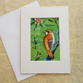 "Danasimson.com Matted art card with envelope, ""Sing your song, all day long"" quote, golden bird image."