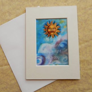 "Danasimson.com Matted art card with envelope, ""Rise and shine your beautiful unique light each day"" quote, sun face image."