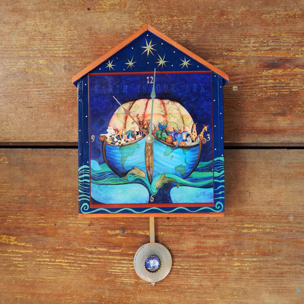 Earth Ark Big Wall Clock with pendulum-houseshaped wooden clock handprinted in waves and fish. The ark is planet earth with all the animals aboard. A pendulum has an elephant on it.