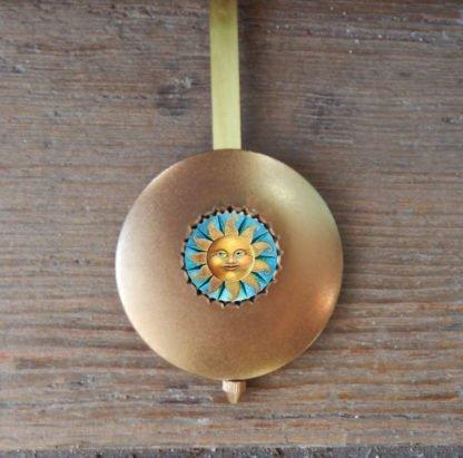 Danasimson.com sun face pendulum