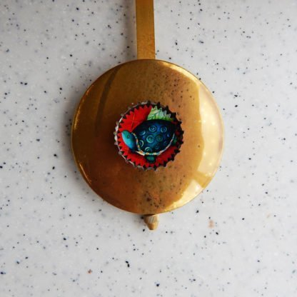 Danasimson.com Journeys the thing wall clock pendulum with turtle in bottle cap.
