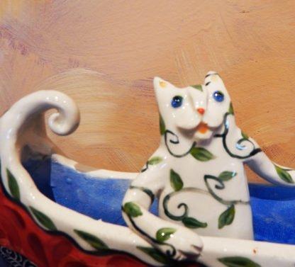 Danasimson.com Cat in canoe on wheels sculpture. detail cat