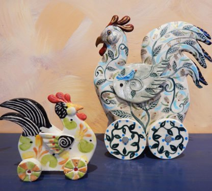 Danasimson.com Roosters on wheels sculptures.