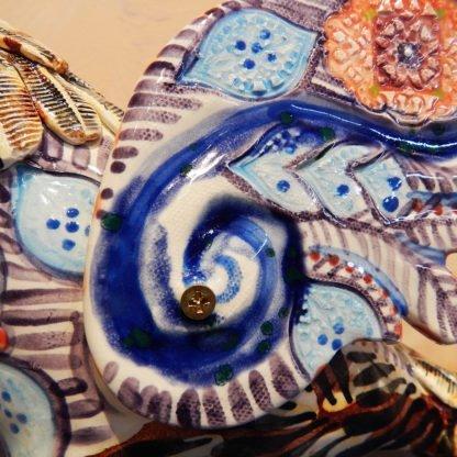 Danasimson.com Owl on wheels sculpture wheel detail