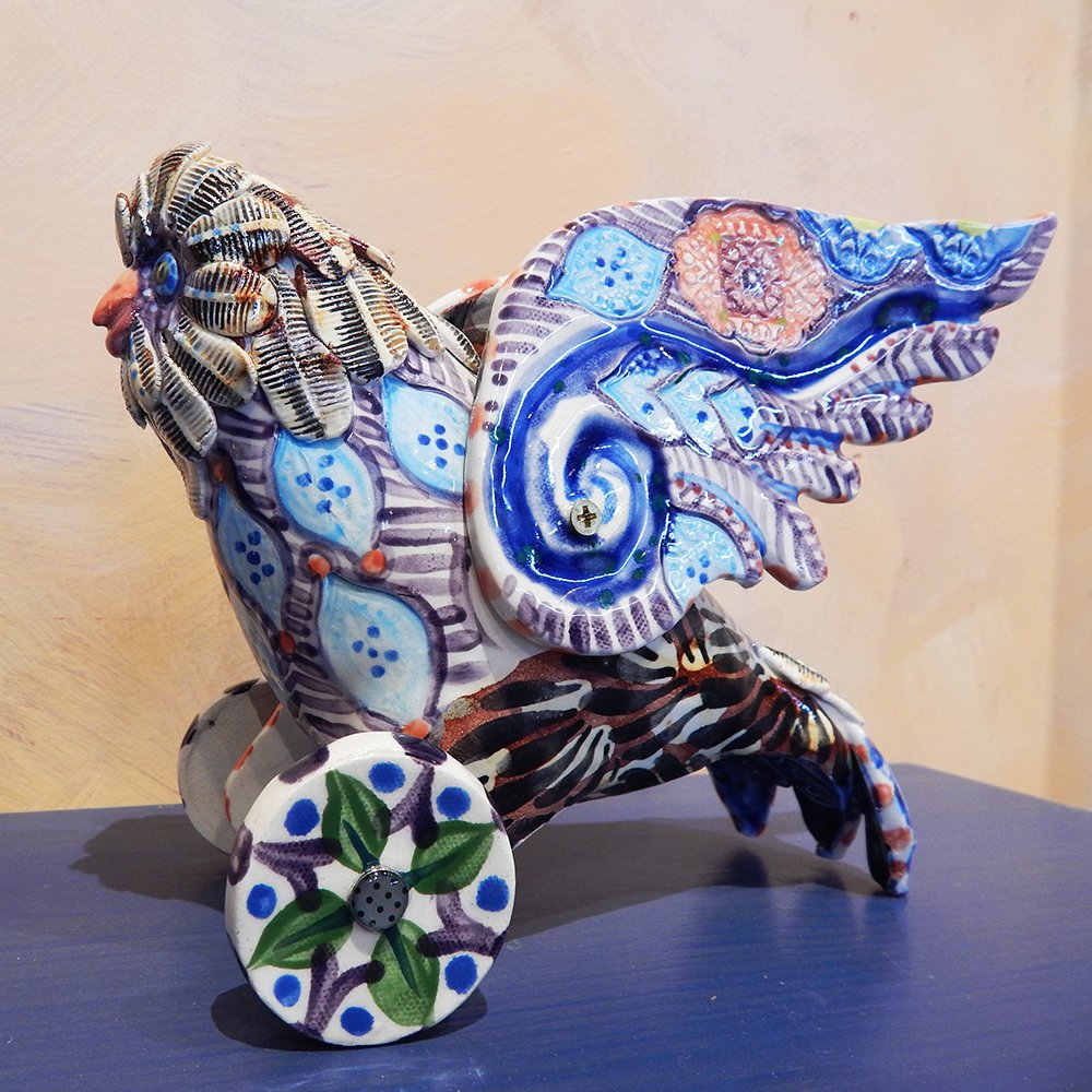 Danasimson.com Owl on wheels sculpture