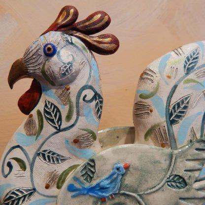 Danasimson.com rolling rooster sculpture face detail