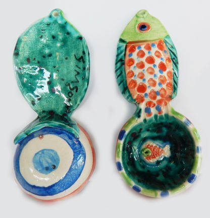 "Danasimson.com Front and back Our handmade Fish handle Coffee Scoop is about 7 inches by 3,"" in colorful ceramic. The handle is a raised design of a fish. A smaller fish is in the bowl of the scoop."