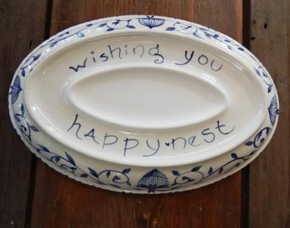 "Danasimson.com Delft Blue birds ""Happy.nest"" Platter showing the bottom with phrase and where a personalized message or names would go."