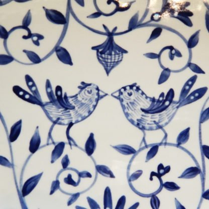 "Danasimson.com Delft Blue birds ""Happy.nest"" Platter closeup of two birds brush work."