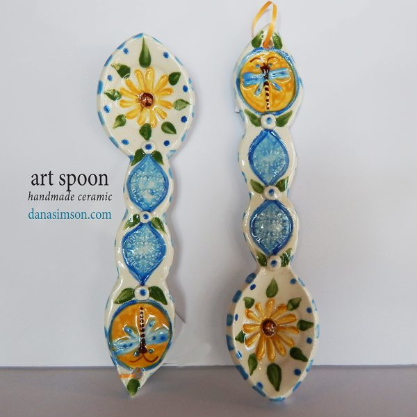 handmade folk artDragonfly & Daisy Ceramic Spoon is cut out, formed in clay and individually decorated using my handmade stamps. The raised imagery detail includes a daisy in the spoon area and dragonfly on the handle.
