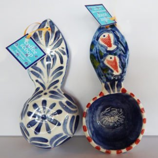 Danasimson.com the Blue Crab coffee scoop is red and blue with fish on the handle and a crab inside the scoop- raised images. measures a half cup.