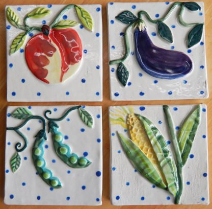 kitchen garden tiles Danasimson.com Custom ceramic tiles for kitchen; peach, eggplant, corn, snap peas.
