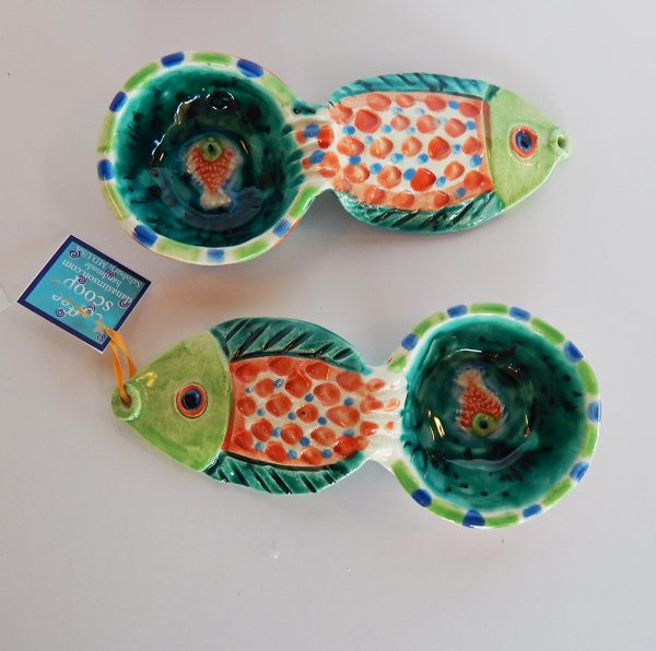 """Our handmade Fish handle Coffee Scoop is about 7 inches by 3,"""" in colorful ceramic. The handle is a raised design of a fish. A smaller fish is in the bowl of the scoop."""