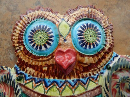 Danasimson.com Owl wall sculpture detail of head eyes and beak. Relief ceramic in colorful glazes.