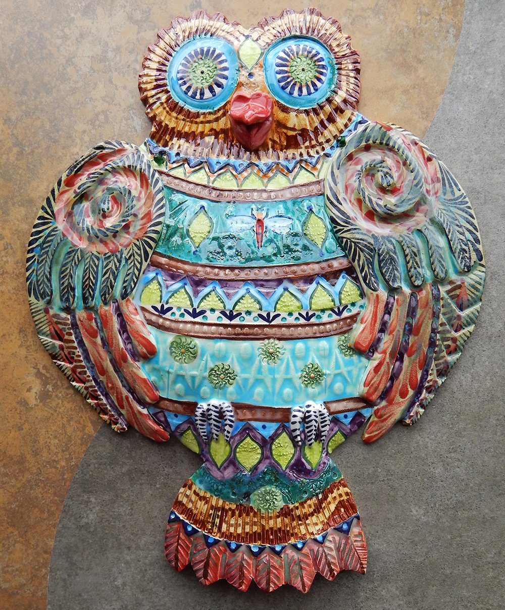 Functional carved birdhouse nest of birds and great horned owl
