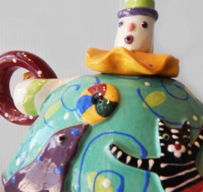 """Danasimson.com Teapot """"My life as a circus"""" detail of his face."""
