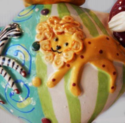 """Danasimson.com Teapot """"My life as a circus"""" detail of a lion."""