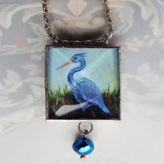 danasimson.com Handcrafted double sided beveled glass pendents with bead detail. Heron image.