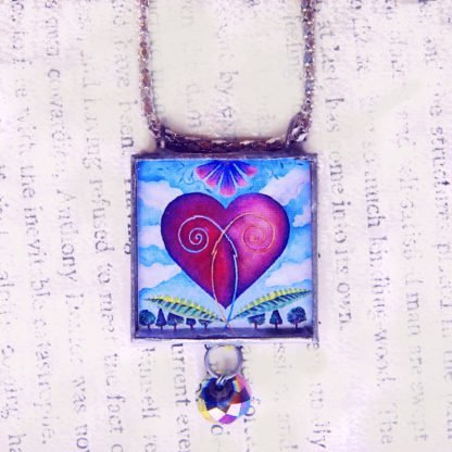 danasimson.com Handcrafted double sided beveled glass pendents with bead detail. Heart image.