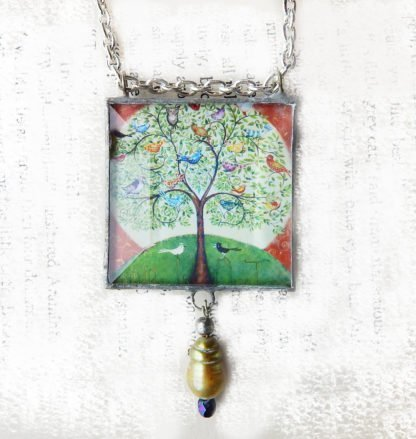 Danasimson.com Handcrafted double sided beveled glass pendent with bead detail. Many Birds One Tree image.