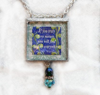 Danasimson.com Handcrafted double sided beveled glass pendent with bead detail