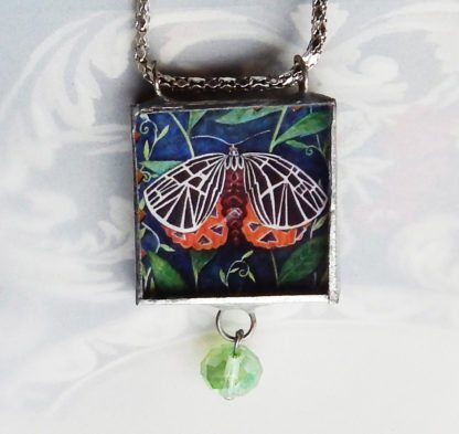 Danasimson.com Looking glass double-sided glass pendent tigarmoth. Beveled glass with a bead detail.
