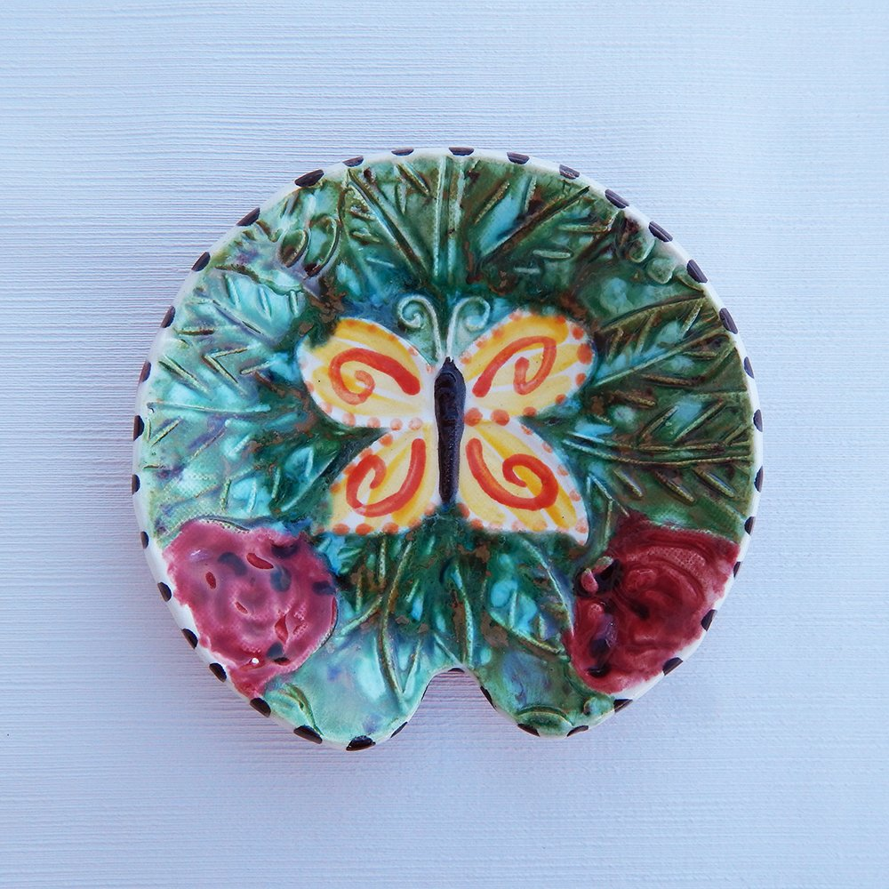 Purchase our handmade ceramic butterfly spoon rest by Dana Simson