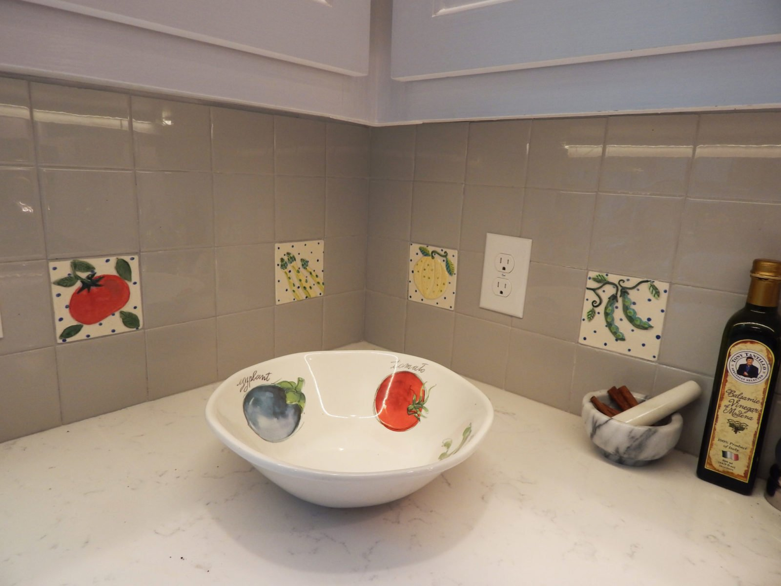 kitchen garden tiles in corner with a ceramic bowl.