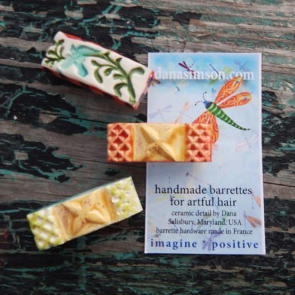 handcrafted ceramic hair clips with tag