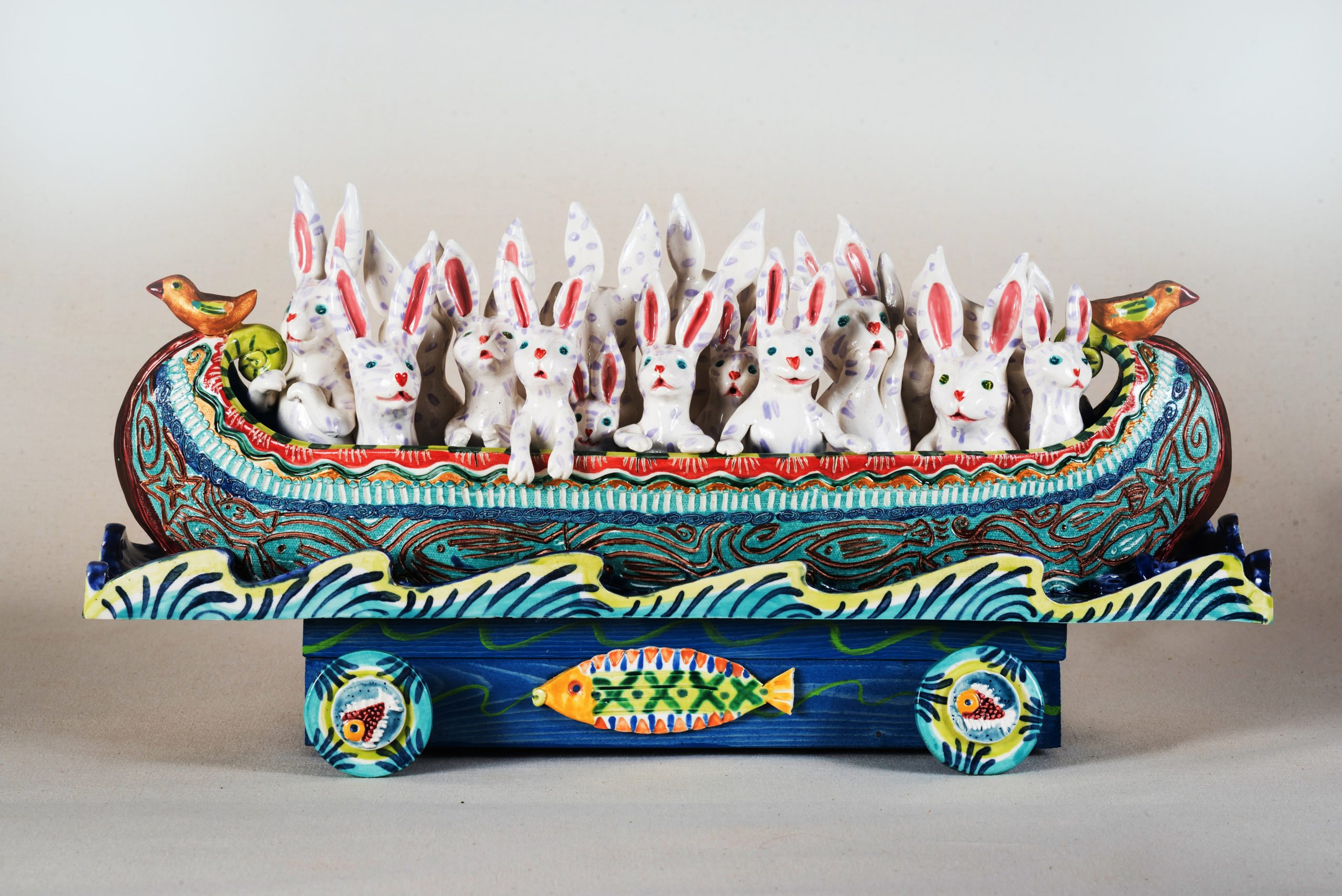 abbits in a folkart boat on wheels depict the issue of migration
