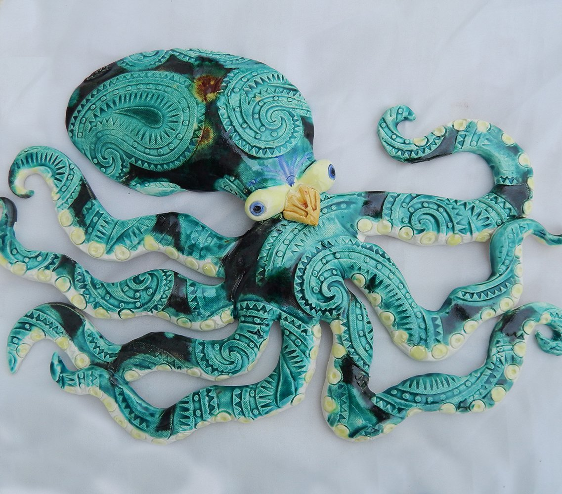 octopus in green and teal wall sculpture