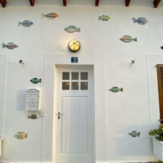 ceramic fish adorn the outside of a villa in Spain
